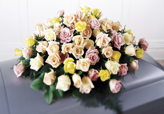 Pastel colored rose casket spray S103 from Fabbrini's Flowers in Hoffman Estates, IL