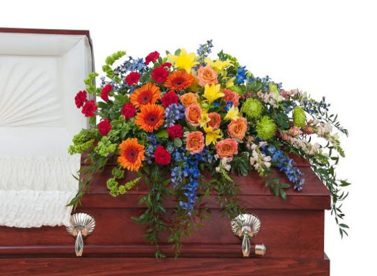 Colorful casket spray S102 from Fabbrini's Flowers in Hoffman Estates, IL