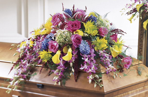 Colorful Spring casket spray S106 from Fabbrini's Flowers in Hoffman Estates, IL