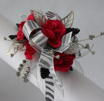 WRIST CORSAGE RED ROSES PC100 from Fabbrini's Flowers in Hoffman Estates, IL